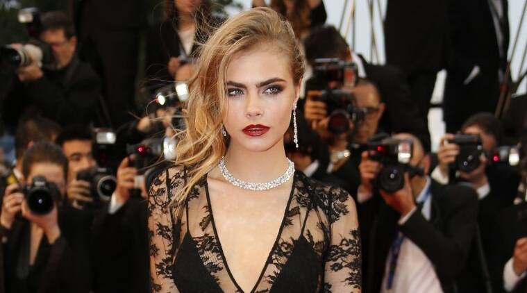 Cara Delevingne Shoots Paparazzi With Water Pistols