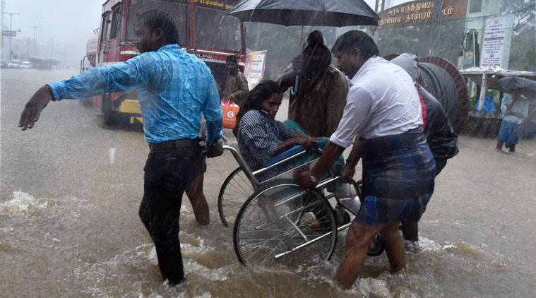 Patients being shifted from a flooded hospital after heavy rains in Chennai. (Source: PTI)