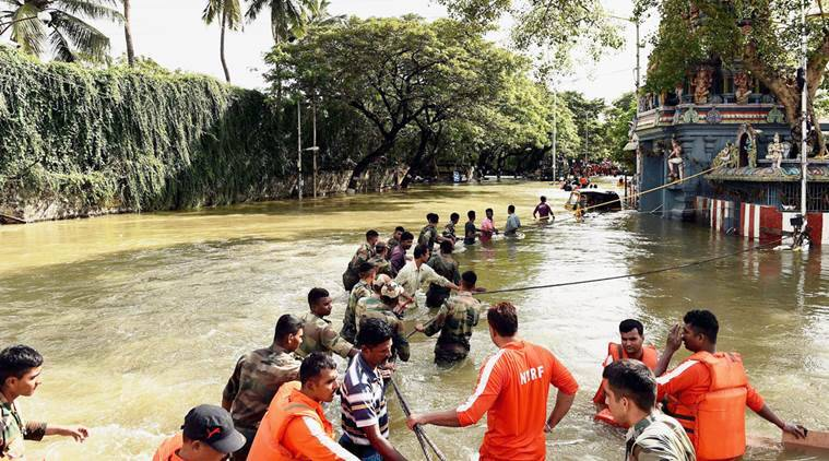 Chennai: Security and NDRF personnel during rescue operation in Chennai after heavy rainfall on Thursday. PTI Photo by R Senthil Kumar(PTI12_4_2015_000015A)