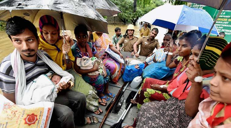 Patients and their care-takers being shifted to safe place from a flooded hospital after heavy rains in Chennai on Tuesday. (Source: PTI)
