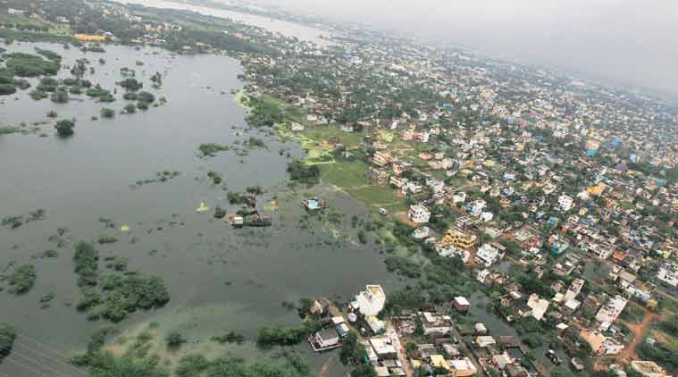 City on its knees: Residential areas are seen surrounded by floodwaters in Chennai on Saturday. (Source: PTI)