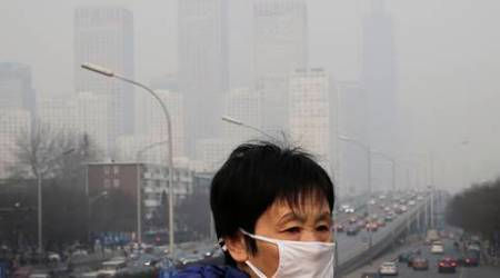 China smog: Beijing shuts down schools, 39 cities issue alerts