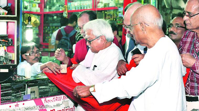 Left Front Chairman Biman Bose collects funds for workers of North Bengal's closed tea gardens, in Kolkata on Tuesday. (Source: Express photo by Partha Paul)