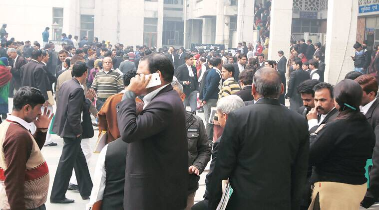 Lawyers, litigants and court staff rushed outside following the shooting in the courtroom Wednesday. (Source: Express photo by Prem Nath Pandey)