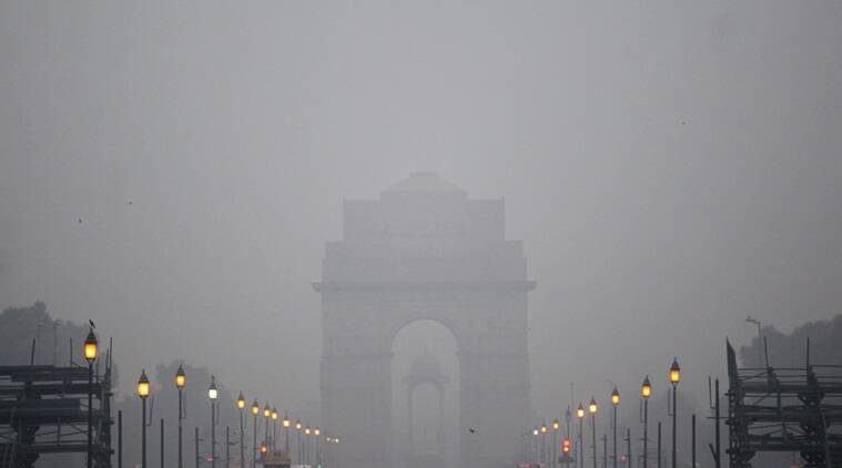 A foggy polluted evening at the Vijaypath facing the Rashtrapati Bhavan in New Delhi on monday. Express Photo by Tashi Tobgyal New Delhi 071215