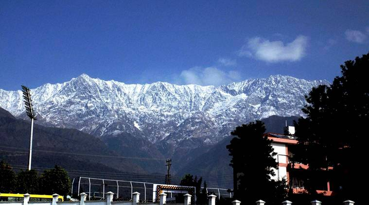Dharamshala: View of snow capped dhauladhar range on Friday morning in Dharamshala, HP.  PTI Photo(PTI11_27_2015_000217A)
