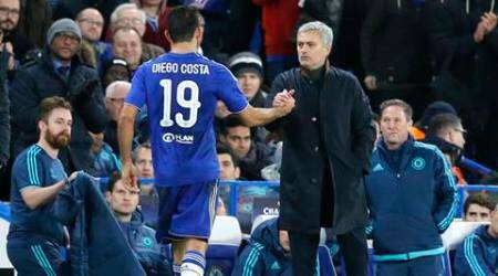 Chelsea manager Jose Mourinho, right, clasps hands with Chelsea's Diego Costa, left, during the Champions League group G soccer match between Chelsea and FC Porto at Stamford Bridge stadium in London, Wednesday, Dec. 9, 2015.(AP Photo/Frank Augstein)