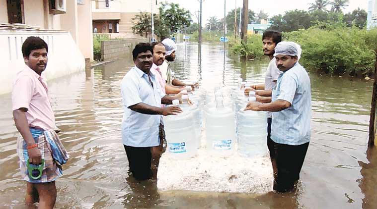People carry bottled drinking water in Chennai on Thursday. (Express Photo by: Johnson T A)