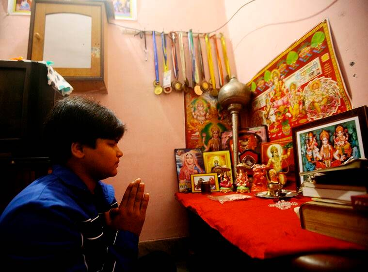 For EYE Story...Indian Junior Women Wrestler Divya pray to God before going to fight Dangal in a Village of Uttar Pradesh. EXPRESS PHOTO BY PRAVEEN KHANNA 05 12 2015.