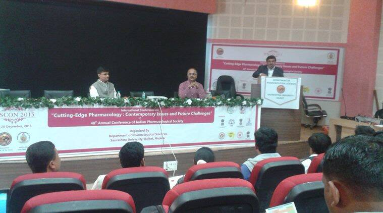 Dr Vallabh Kathiria addresses symposium as V-C Rajesh Kotecha (extreme left) looks on at IPSCON 2015, in Rajkot on Friday.