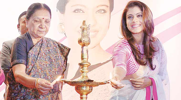 Chief Minister Anandiben Patel and Kajol light lamps at the Vibrant Garima Business Women Conclave 2015 in Ahmedabad on Saturday. (PTI Photo)