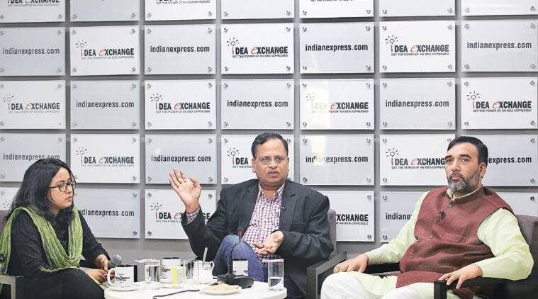 Satyendar Jain (left) and Gopal Rai with Assistant Editor Mayura Janwalkar at The Indian Express office. (Express photo by Ravi Kanojia)