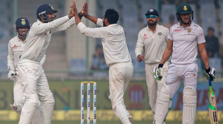 Indian team members celebrate the wicket of South Africa's Faf du Plessis, on the last day of their fourth and final test cricket match in New Delhi, India, Monday, Dec. 7, 2015. (AP Photo/Tsering Topgyal)