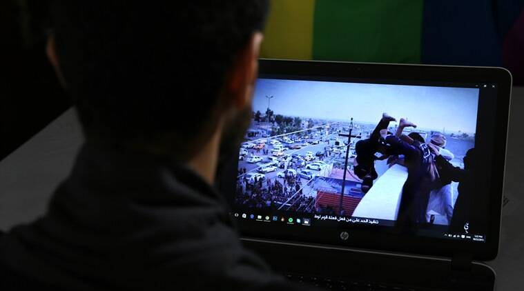 GRAPHIC CONTENT - In this Oct. 22, 2015, photo, Daniel Halaby, a gay Syrian living in southern Turkey, shows a photo from his laptop of Islamic State group militants throwing a man off a roof for allegedly violating the extremists' ban on homosexuality. Halaby told The Associated Press that even two years after fleeing to Turkey to escape IS, he wakes up from nightmares that he has been captured and is about to be thrown off a building. Halaby spoke on the condition that he be identified by the name he uses in his political activism, and that neither his face nor location be revealed. (AP Photo/Hussein Malla)