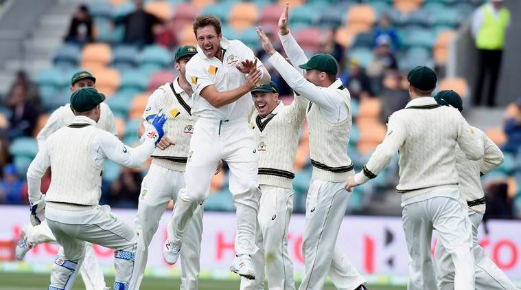 Australia's James Pattinson, center, celebrates with teammates after dismissing West Indies' Jermaine Blackwood during their cricket test match in Hobart, Australia, Saturday, Dec. 12, 2015. (AP Photo/Andy Brownbill)