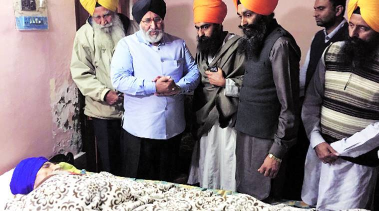 Education Minister Daljit Singh Cheema (2nd from left) at Surat Singh Khalsa's residence at Hassanpur on Wednesday. Express