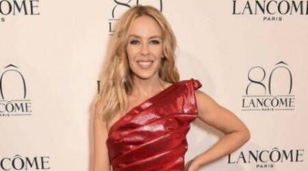 Kylie Minogue duets with boyfriend at Christmas party
