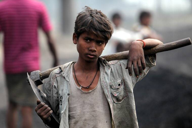 A child labourer works at the Katra railway station to unload coal in Gonda, Uttar Pradesh.Express Photo by Ravi Kanojia