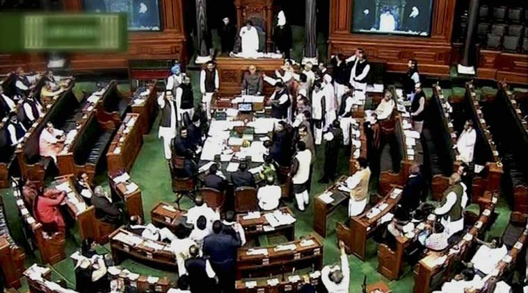 File photo of Members protest in the Lok Sabha in New Delhi. (Source: PTI)