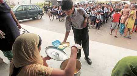 HRD ministry makes Aadhaar mandatory for students, cooks under midday meal scheme