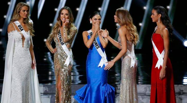 The final five contestants, including Miss Philippines Pia Alonzo Wurtzbach, center, react on stage at the Miss Universe pageant Sunday, Dec. 20, 2015, in Las Vegas. (AP Photo/John Locher)