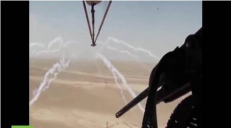Aerial footage shot from helicopter shows Iraqi army pounding IS targets