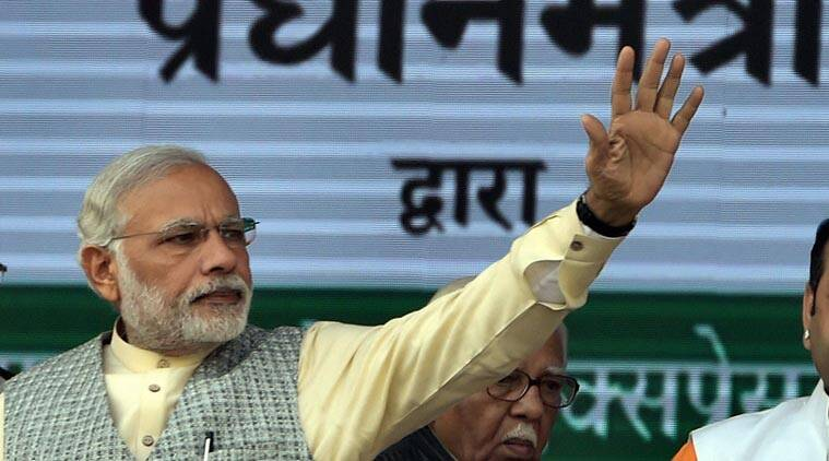 Prime Minister Narendra Modi waves during the foundation stone laying ceremony for the construction of Delhi-Dasna-Meerut Expressway and upgradation of Dasna- Hapur Section of NH-24, in Noida on Thursday. (PTI Photo)