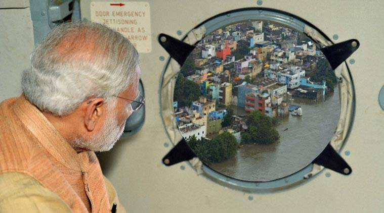 The doctored photo of Narendra Modi surveying the flood situation in Chennai, as released by PIB.