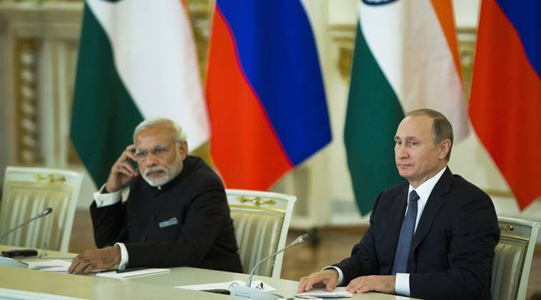 Russian President Vladimir Putin, right, and Indian Prime Minister Narendra Modi attend a meeting with Russian and Indian officials and businessmen in the Kremlin in Moscow, Thursday, Dec. 24, 2015. (AP Photo/Pavel Golovkin)