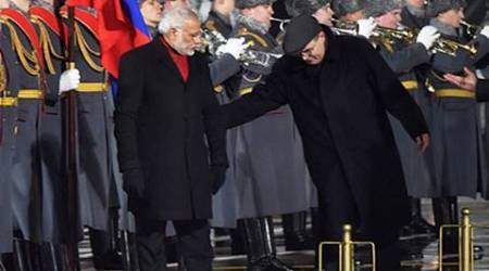Moscow : Prime Minister Narender Modi during a guard of honour on his arrival at Vnukovo-2 Airport in Moscow on Wednesday. PTI Photo by Shahbaz Khan (PTI12_23_2015_000324B)