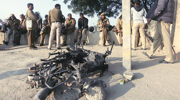 The mob set a police bike on fire after the accident at Shahbad Dairy area Thursday morning. (Express photo by Amit Mehra)