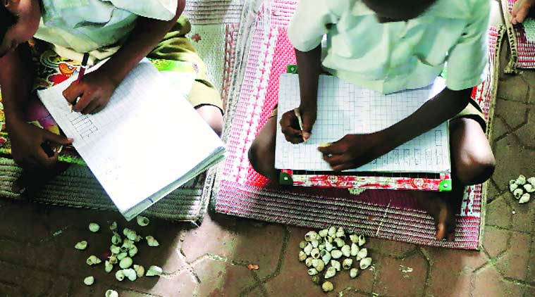 A class in progress at Manavya where students learn to count using sea shells