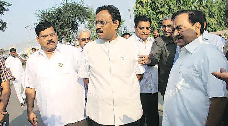 Education Minister Vinod Tawde and Revenue Minister Eknath Khadse outside the Vidhan Bhawan in Nagpur Thursday. (Express Photo by: Monica Chaturvedi)