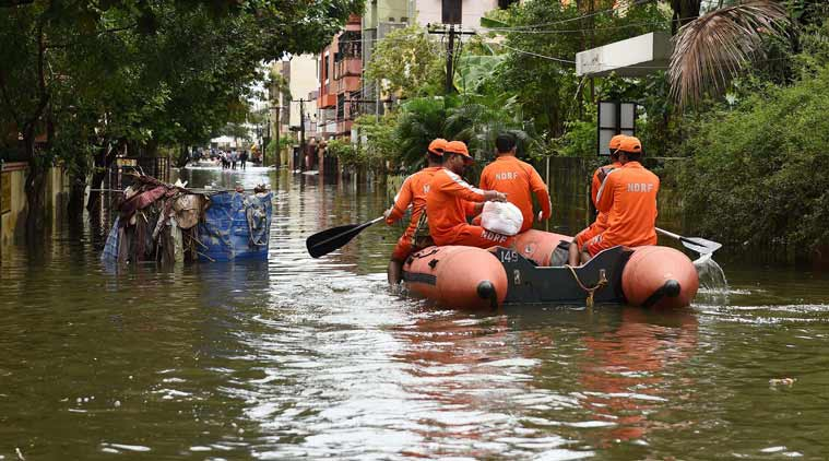 National Disaster Response Force (NDRF) team carrying out relief works in Velachery, one of the worst flood-hit areas in Chennai on Saturday. (PTI Photo)