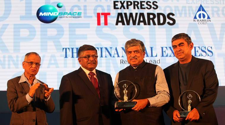 Nandan Nilekani receiving the Lifetime Achievement award from  Ravi Shankar Prasad as NR Narayana Murthy and Vishal Sikka, winner of Newsmaker of the year winner looks on during the Express IT Awards in Bengalore on Dec 4th 2015. Express photo by Ravi Kanojia.
