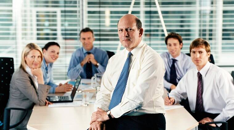 Portrait of a CEO With His Team of Business Executives in a Boardroom