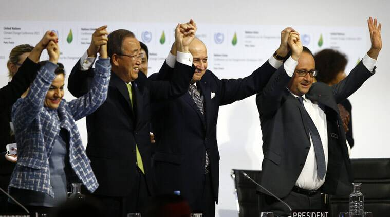 French President Francois Hollande, right, French Foreign Minister and president of the COP21 Laurent Fabius, second, right, United Nations climate chief Christiana Figueres and United Nations Secretary General Ban ki-Moon hold their hands up after the final conference at the COP21, the United Nations conference on climate change, in Le Bourget, north of Paris, Saturday, Dec.12, 2015. (Source: AP)