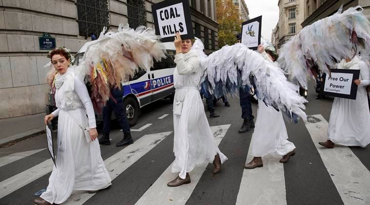 """Activists of """"Climacts Angels Guardians"""" from Australia arrive for a demonstration in Paris, Thursday, Dec. 3, 2015 . The protest is one of many activist actions linked to the COP21, the United Nations Climate Change Conference. (AP Photo/Christophe Ena)"""