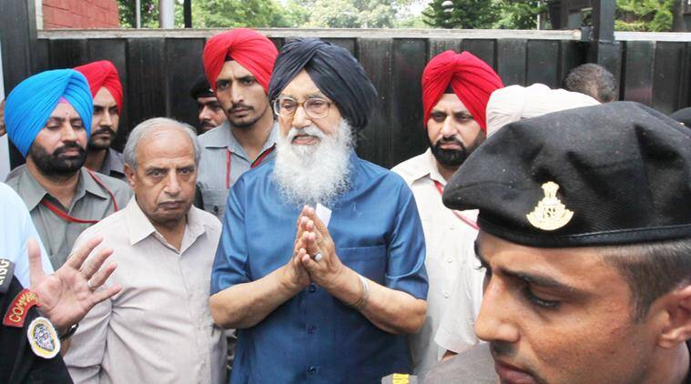 Chief Minister Punjab Parkash Singh Badal waiting outside the gate of CM residence for Congress Party protesters Capt Amarinder Singh and other Congress MLAs during their protest against Punjab Government on Farmers Issue, at his official residence in Sector 2 of Chandigarh on Friday, August 21 2015. Express Photo by Kamleshwar Singh