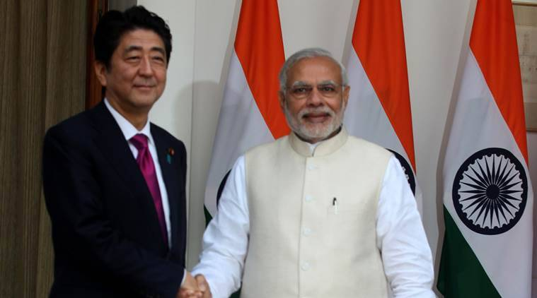 Prime Minister Narendra Modi shakes hands with his Japanese counterpart Shinzo Abe ahead of their meeting at Hyderabad House in New Delhi December 12, 2015. (Express photo by Renuka Puri)