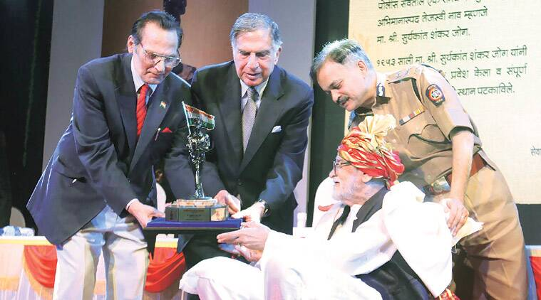 Ex-DGP Arvind Inamdar, Chairman of Tata Sons Ratan Tata and city police chief Ahmad Javed felicitate former cop Suryakant Jog at Veer Savarkar hall in Shivaji Park. (Source: Express photo by Dilip Kagda)