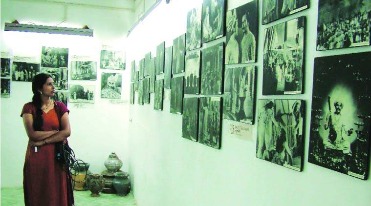 A visitor takes a look at cinematic images at Prabhat museum. Express photo