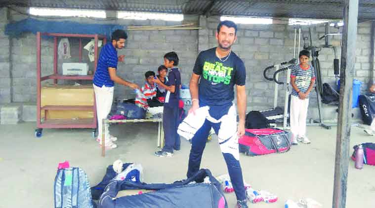 Cheteshwar Pujara at his academy on the outskrits of Rajkot. (Express Photo by: Devendra Pandey)