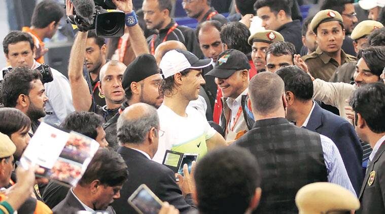 People made a beeline for Rafael Nadal, seeking autographs, photographs and taking selfies at the IG Stadium on Thursday. (Source: Express Photo by Ravi Kanojia)
