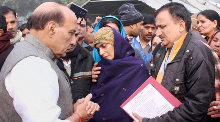 Union Home Minister Rajnath Singh meeting the family members of the BSF plane crash victims during a wreath laying ceremony for them at Safdarjung airport in New Delhi on Wednesday. (PTI Photo)