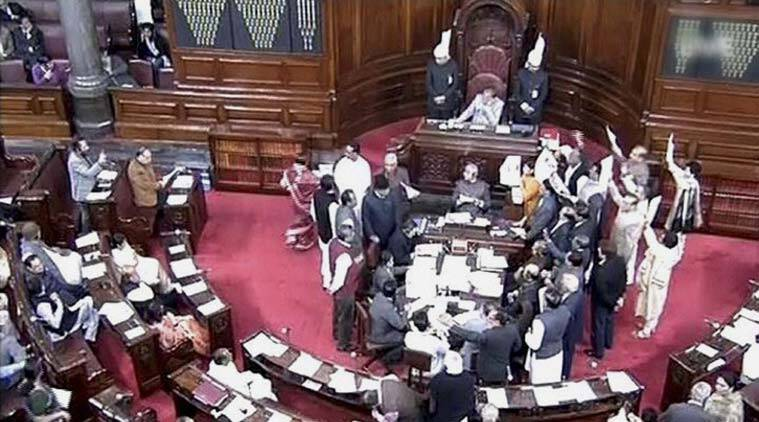 Opposition members protest in the well of the Rajya Sabha in New Delhi on Monday.(Source: PTI)