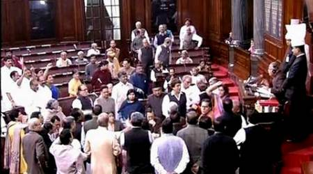 New Delhi: Members protest in the Rajya Sabha during the ongoing winter session of Parliament  in New Delhi on Thursday. PTI Photo/TV Grab(PTI12_10_2015_000062B)