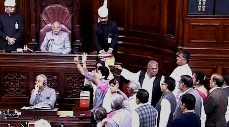 New Delhi: Opposition members protesting in Rajya Sabha during the winter session of Parliament in New Delhi on Thursday. PTI Photo / TV GRAB (PTI12_3_2015_000062A)