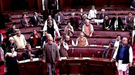 New Delhi: Opposition members protest in the Rajya Sabha in New Delhi on Tuesday. PTI Photo / TV GRAB  (PTI12_22_2015_000270A)