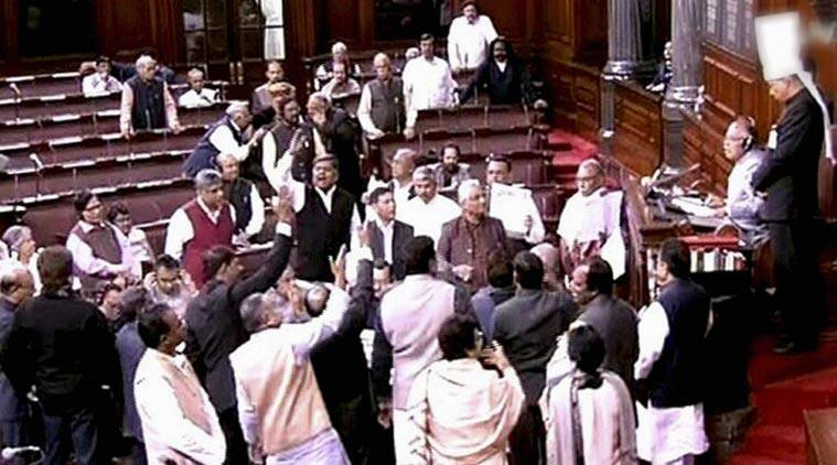 Opposition members protest in the well of the Rajya Sabha. (Source: PTI)